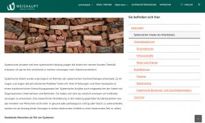 weiße Website mit grünem Kopfbereich und einem Stapel Feuerholz über einem Text